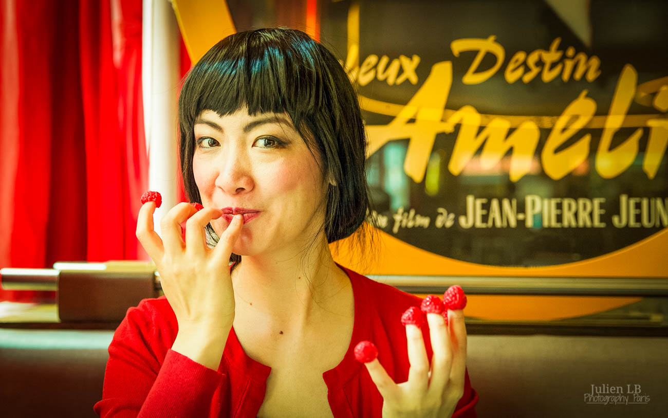 Amelie inspired photoshoot Amelie costume Montmartre Paris France travel cosplay Eating raspberries off fingers Cafe des deux moulins